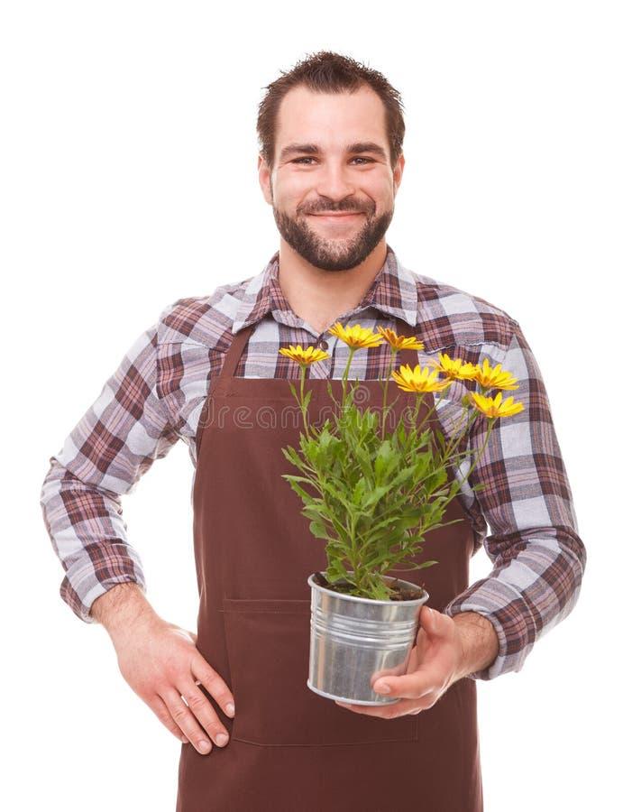 有花的年轻花匠 库存照片