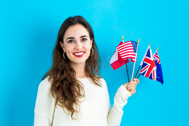 有英文国家旗子的妇女  库存照片