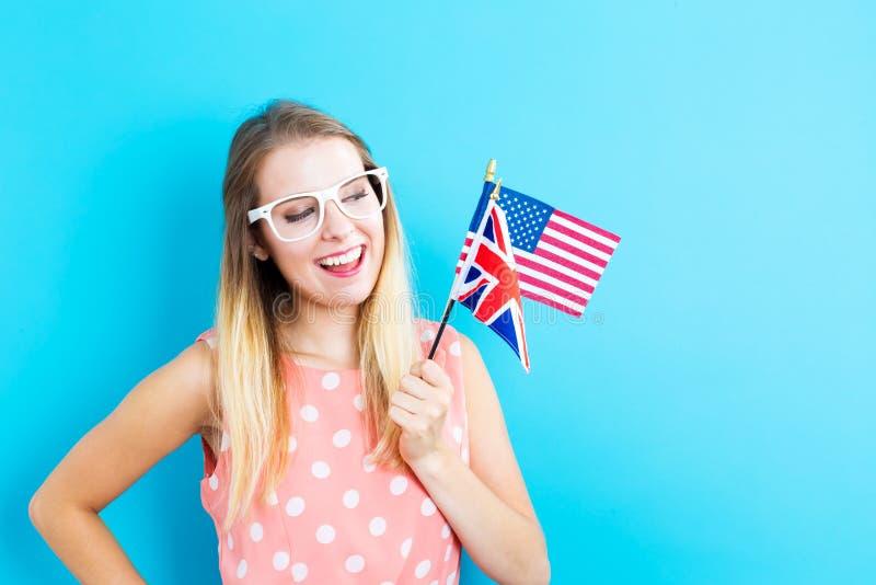 有英文国家旗子的妇女  免版税库存照片