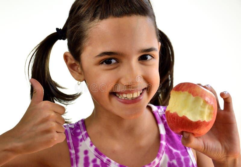 有苹果计算机的西班牙孩子 库存照片