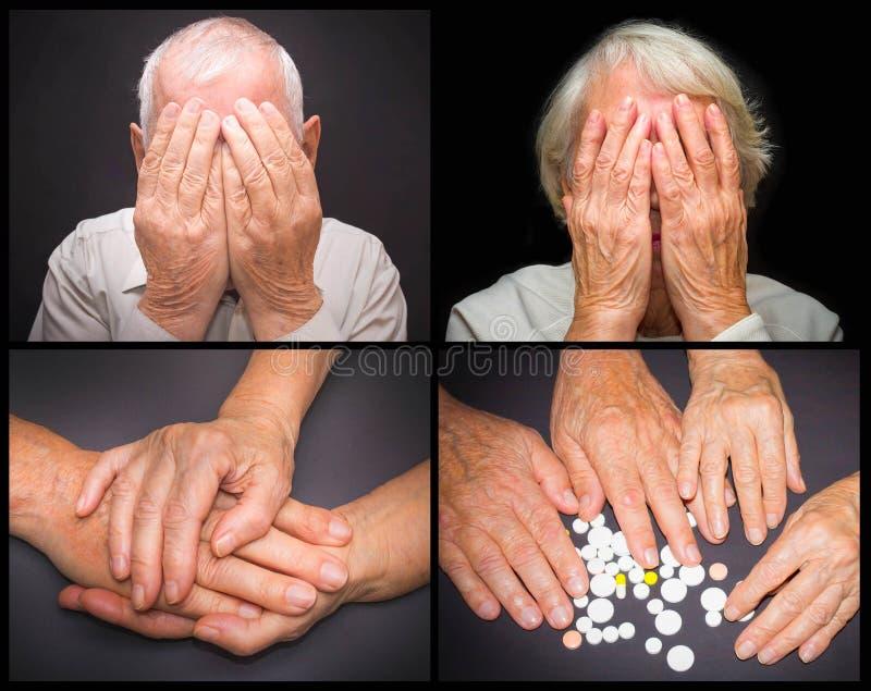 有药片的老手 免版税库存照片
