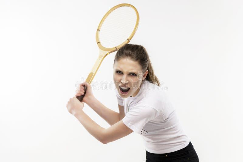 有葡萄酒网球拍的女孩 免版税库存图片