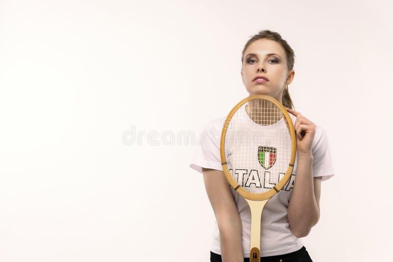 有葡萄酒网球拍的女孩 图库摄影
