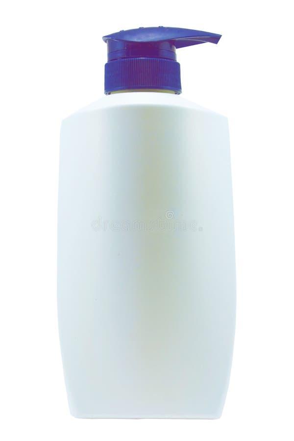 有蓝色分配器泵浦的塑料干净的白色瓶在白色背景 免版税库存照片