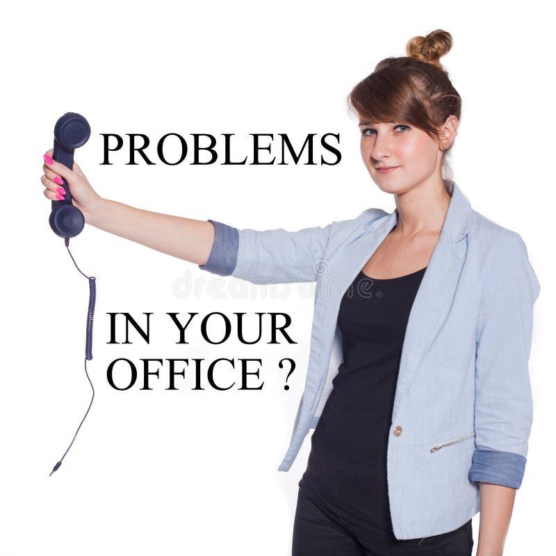 有蓝色电话机的女实业家。隔绝在白色bac 库存照片