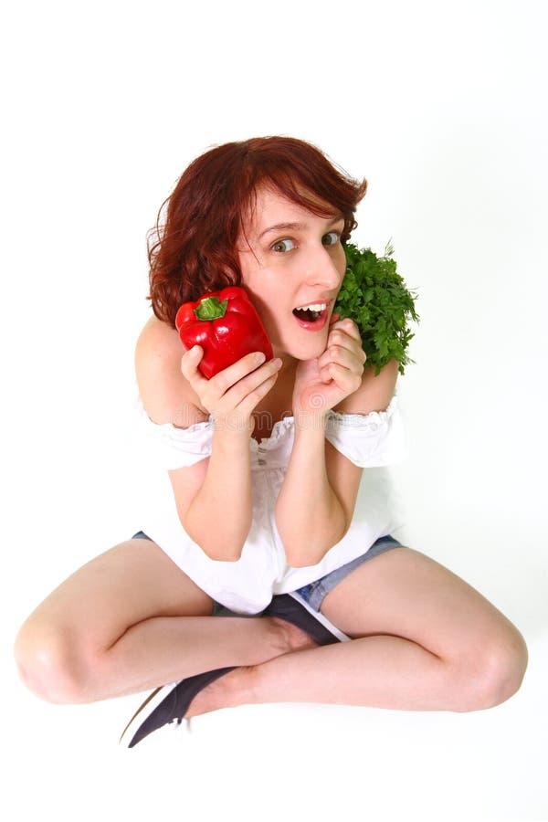 有蔬菜的惊奇少妇 免版税库存照片