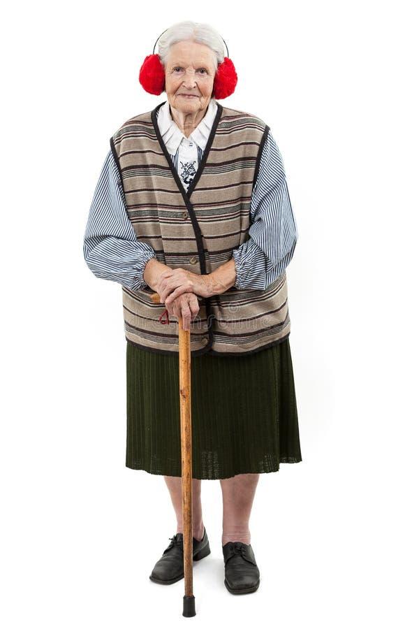 有藤茎佩带的虚假毛皮耳朵笨拙的人的老妇人 免版税库存图片