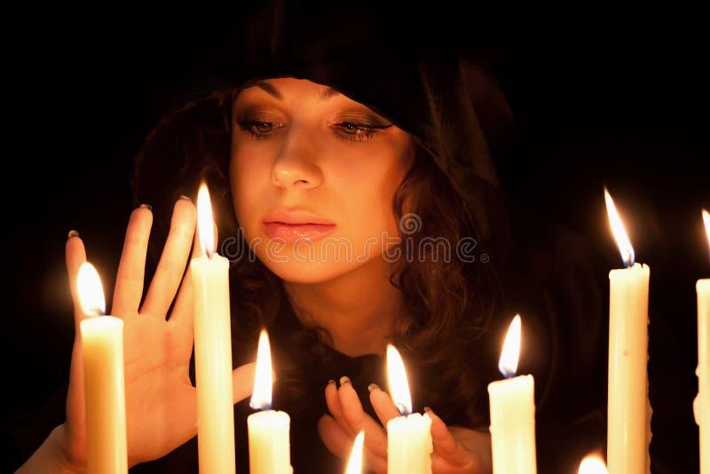 有蜡烛的妇女 库存图片