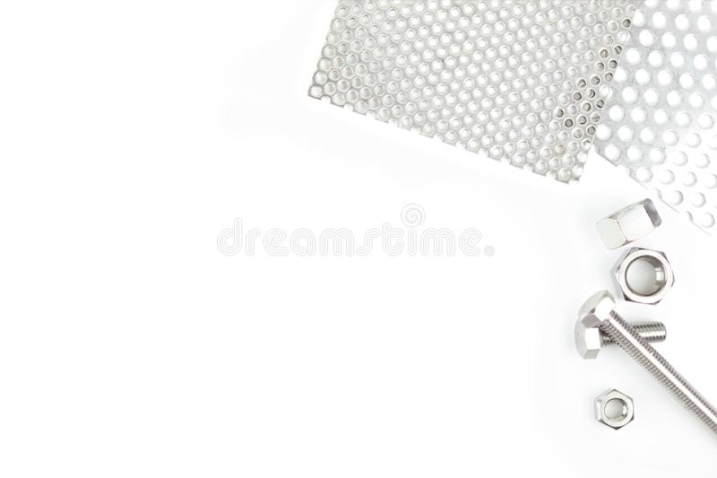 有螺栓的不锈钢坚果在白色背景 库存图片