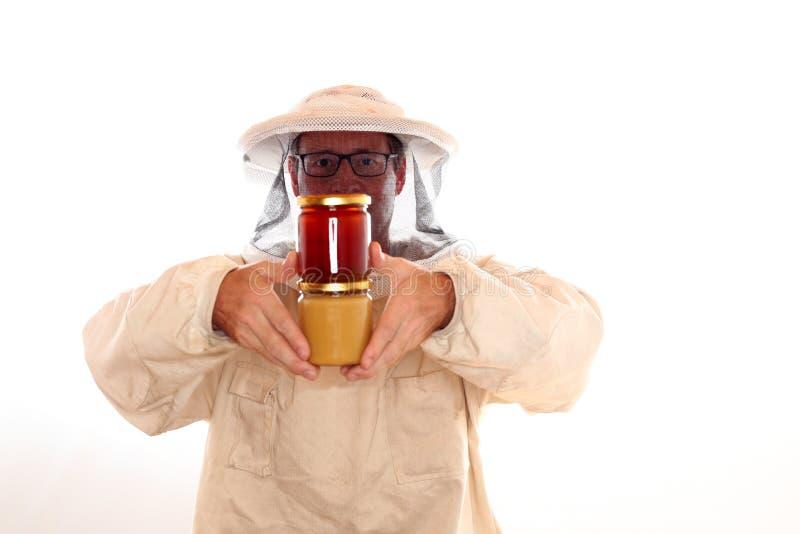 有衣裳的养蜂家 免版税库存照片