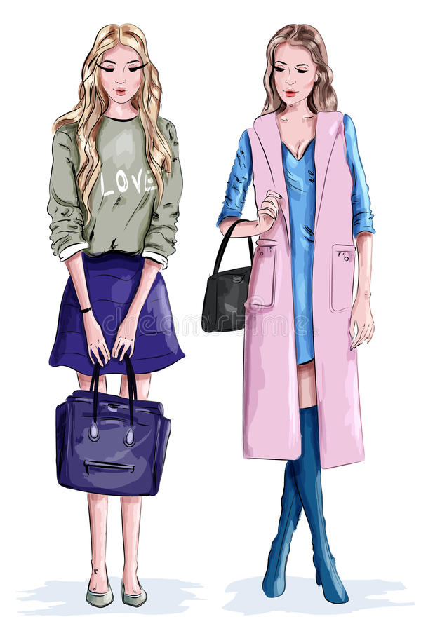 有袋子的两个美丽的时髦的女孩 时尚衣裳的逗人喜爱的妇女 皇族释放例证