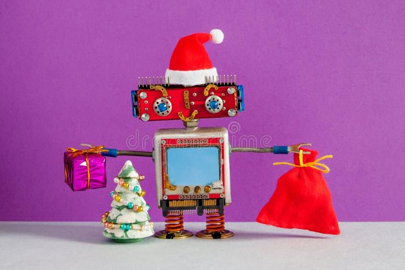 有袋子的愉快的圣诞老人项目机器人礼物 与圣诞老人的圣诞节新年贺卡大模型兴高采烈的机器人字符 图库摄影