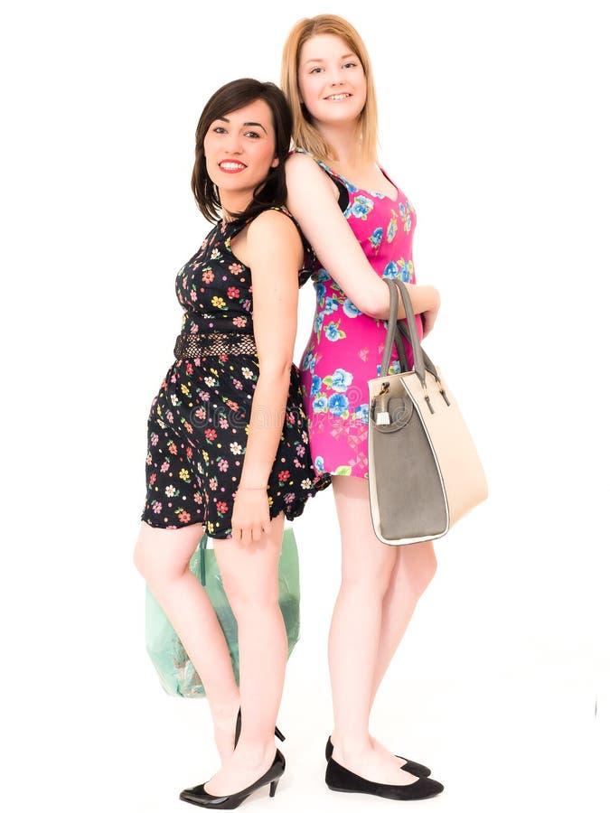 有袋子的愉快的微笑的购物妇女 免版税库存照片
