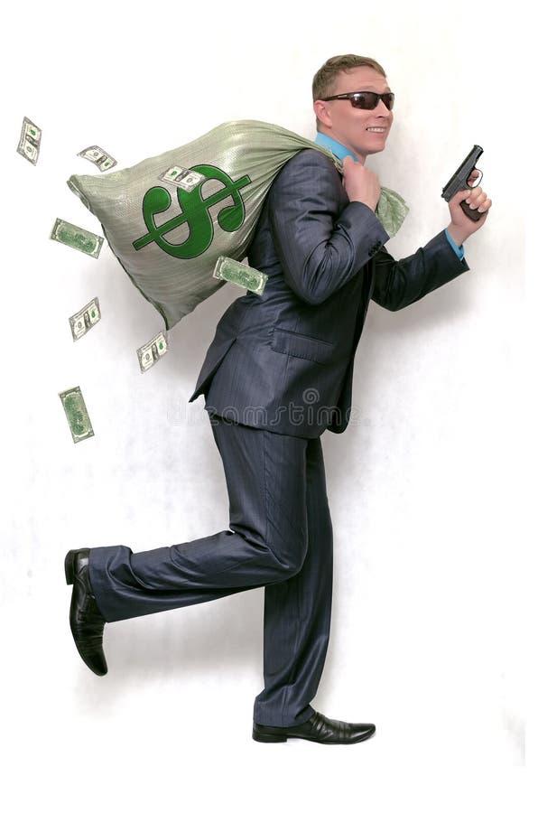 有袋子的银行抢劫犯有很多金钱和枪 免版税库存照片