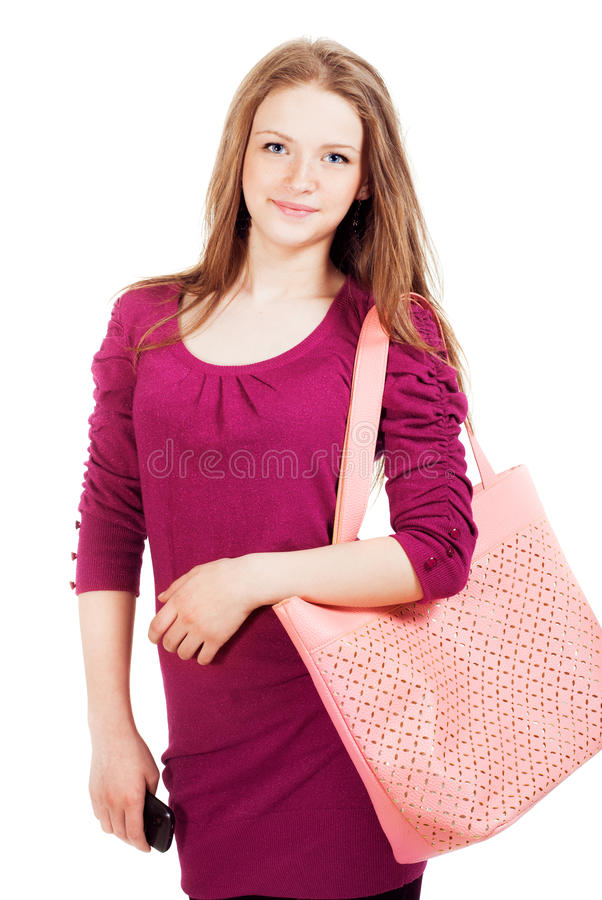 有袋子的青少年的女孩 免版税库存图片