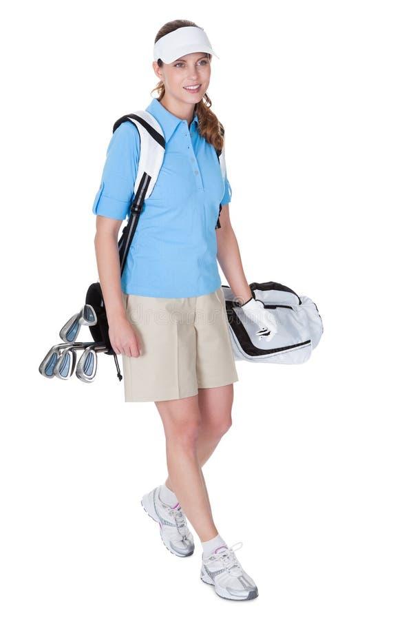 有袋子的高尔夫球运动员俱乐部 库存图片