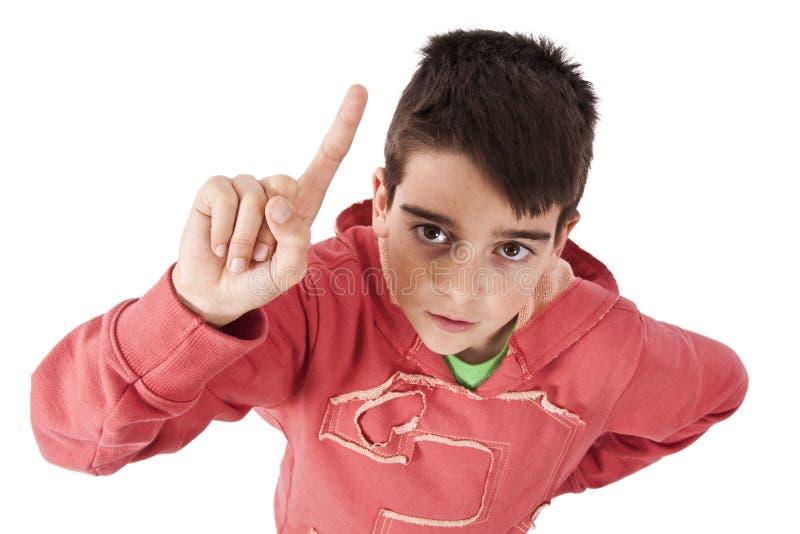 有被举的手指的孩子 免版税库存照片