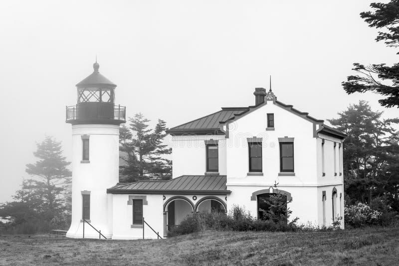 有被困扰的神色的黑白灯塔 免版税库存照片