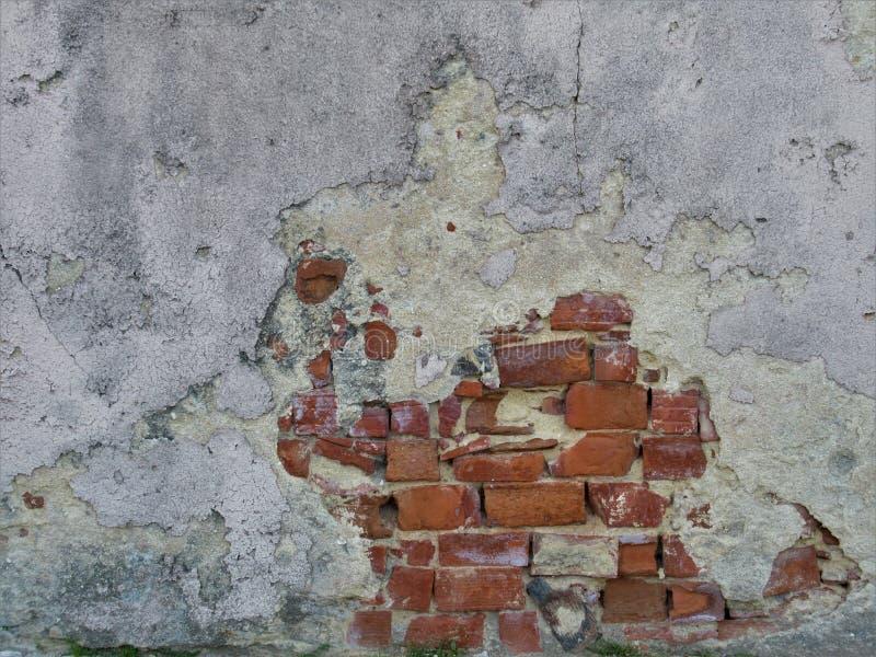 有被暴露的砖的混凝土墙 库存图片