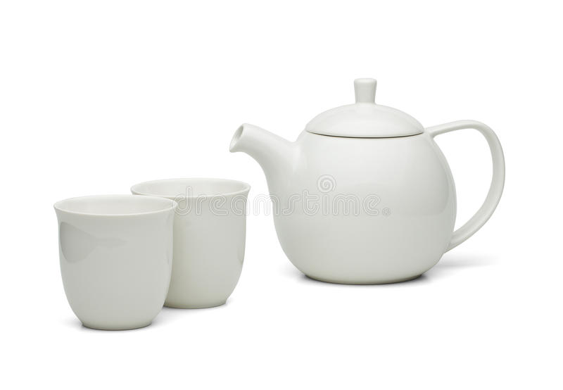 有被设置的茶杯的白色茶罐 免版税库存图片