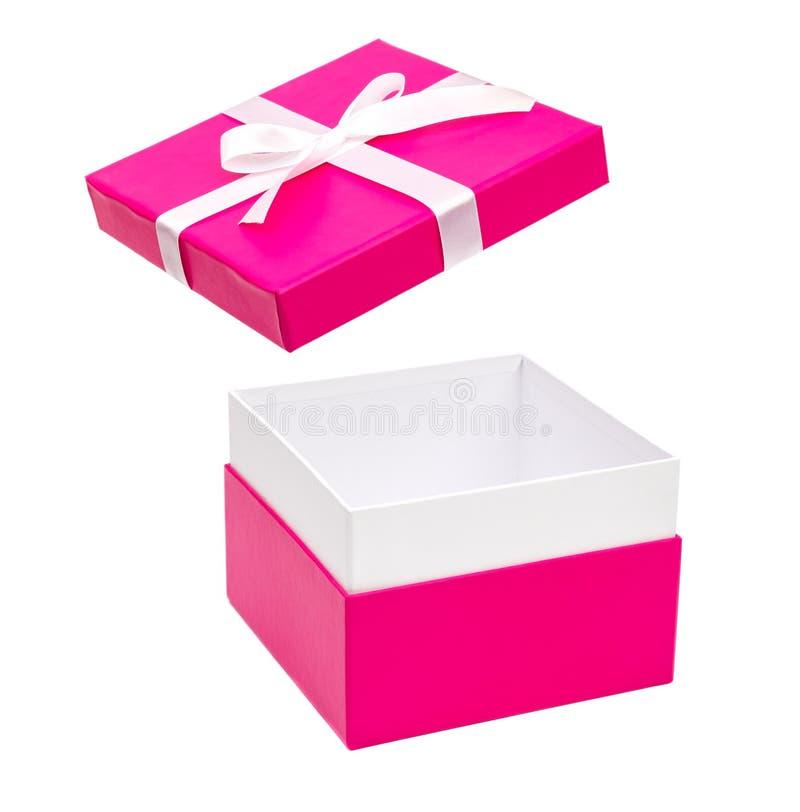 有被隔绝的白色丝带的桃红色礼物盒 库存照片