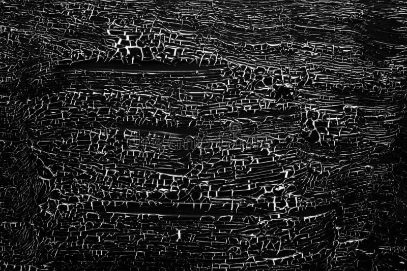 有裂痕的油漆黑在白色01 免版税图库摄影
