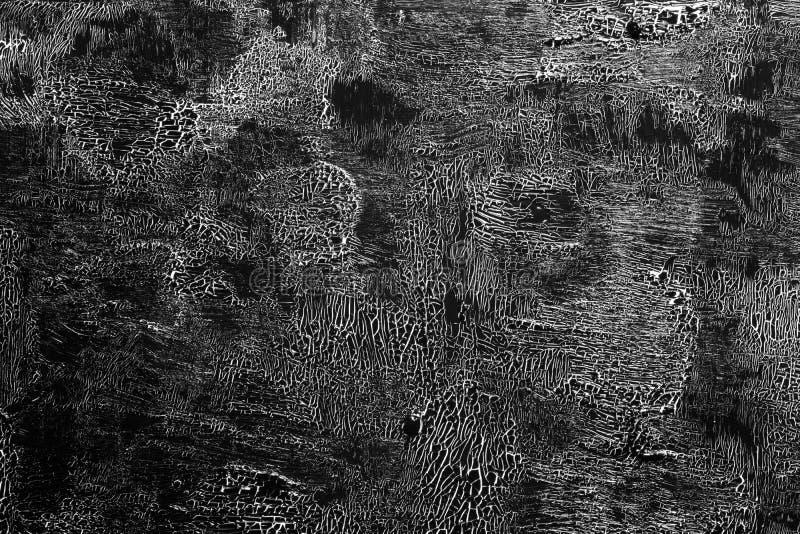 有裂痕的油漆黑在白色01 库存照片