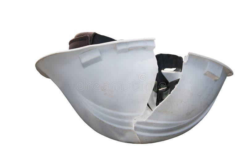 有裂缝的安全帽 库存照片