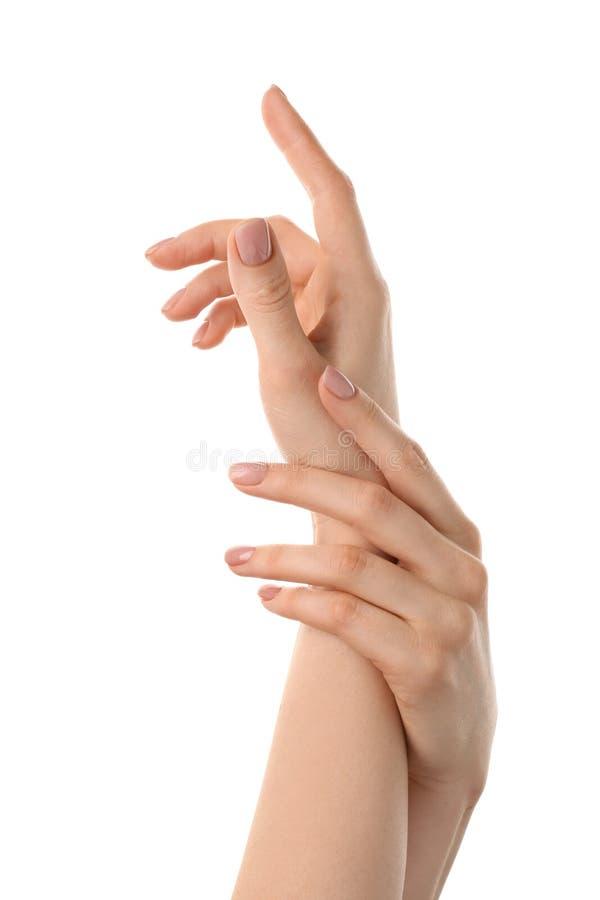 有裸体修指甲的女性手在白色背景 免版税图库摄影