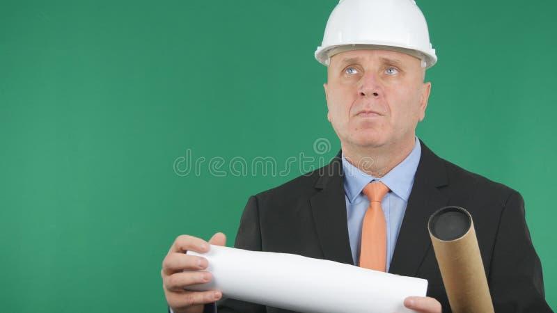 有计划的工程师在今后看的手上 免版税库存图片