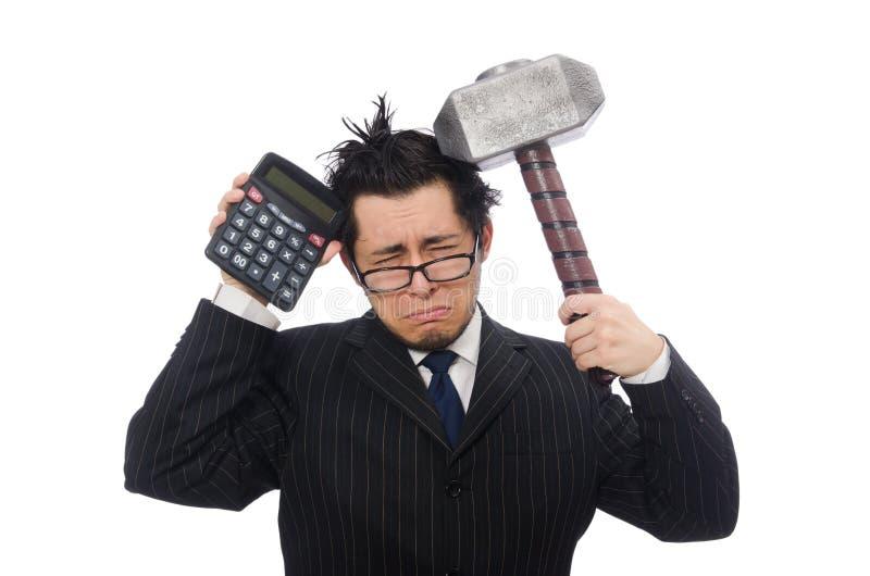 有计算器和锤子的年轻滑稽的雇员 免版税库存照片