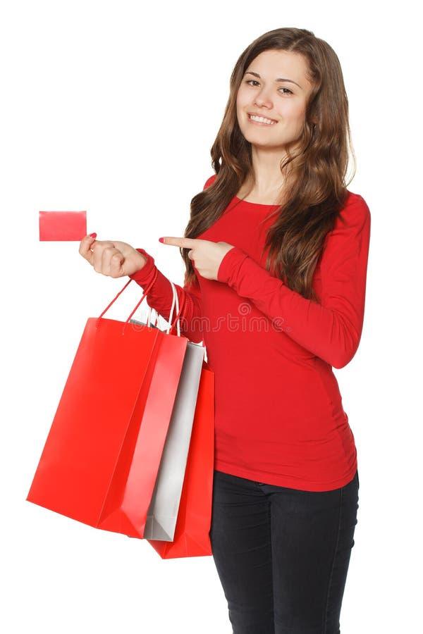 有许多购物袋和信用卡的妇女手 库存照片