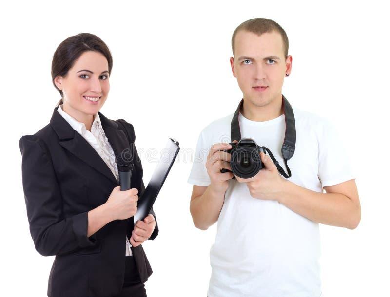 有话筒和操作员的女性新闻工作者有照相机isola的 免版税图库摄影