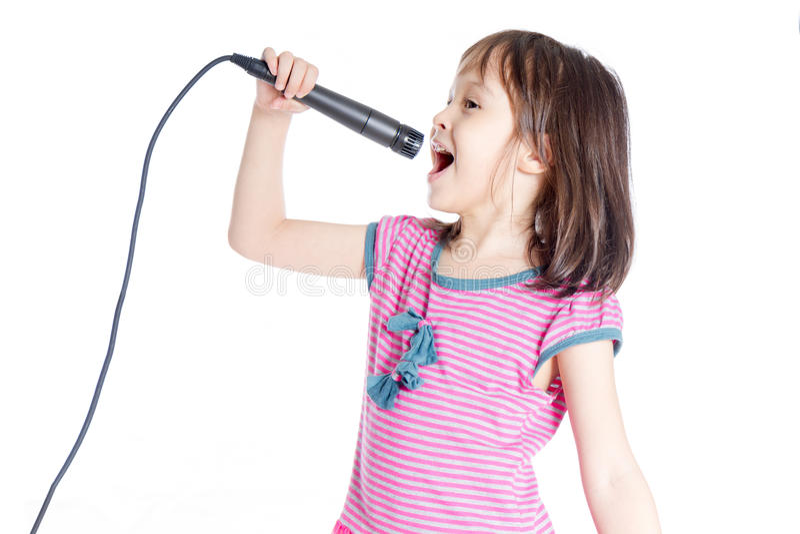 有话筒的女孩 免版税图库摄影