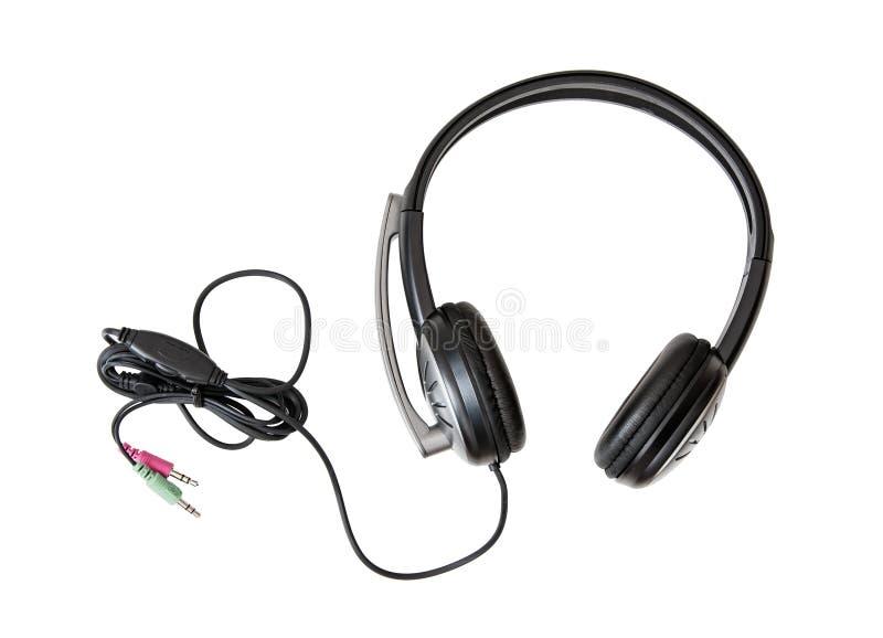 有话筒的新的耳机在白色背景 库存图片