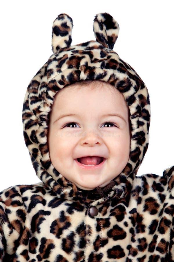 有豹子服装的可爱的女婴 免版税图库摄影