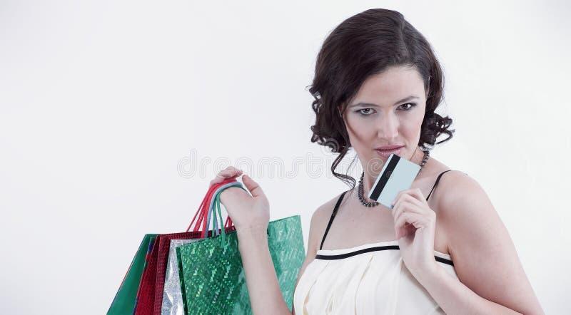 有购物和信用卡的成功的少妇 库存图片