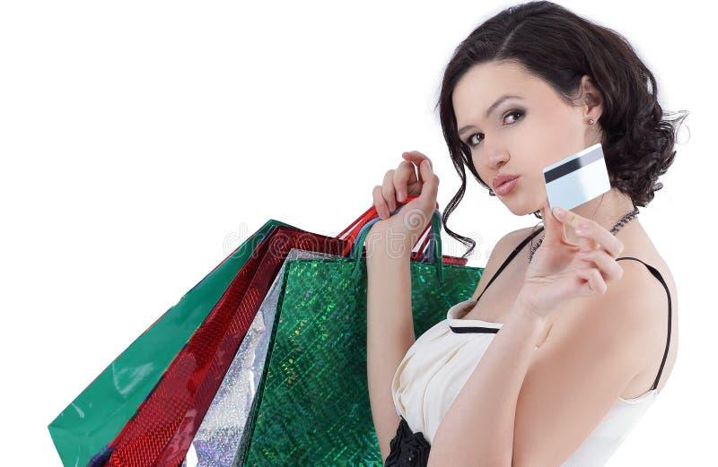 有购物和信用卡的成功的少妇 免版税库存照片