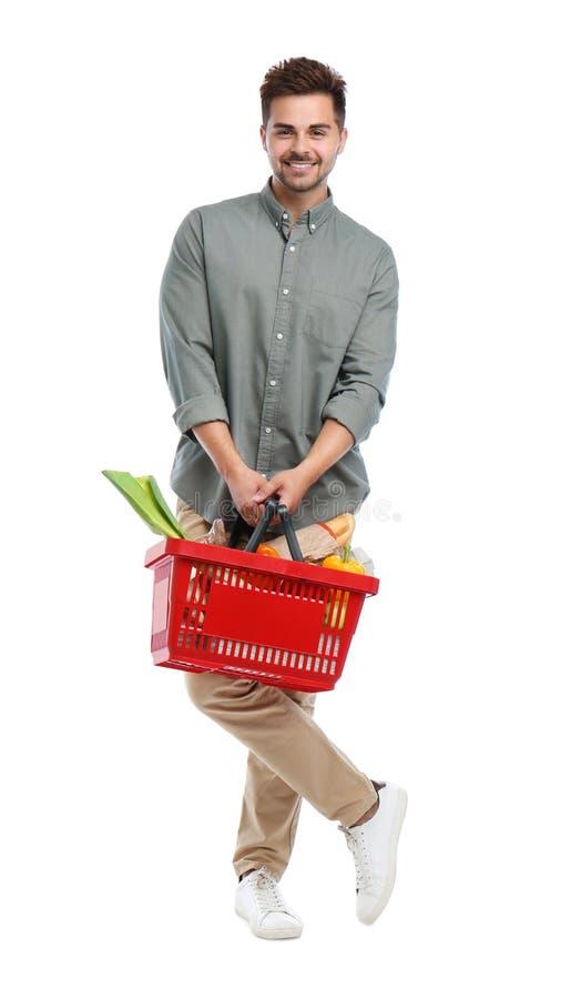 有购物的年轻人在白色隔绝的有很多产品 免版税库存图片