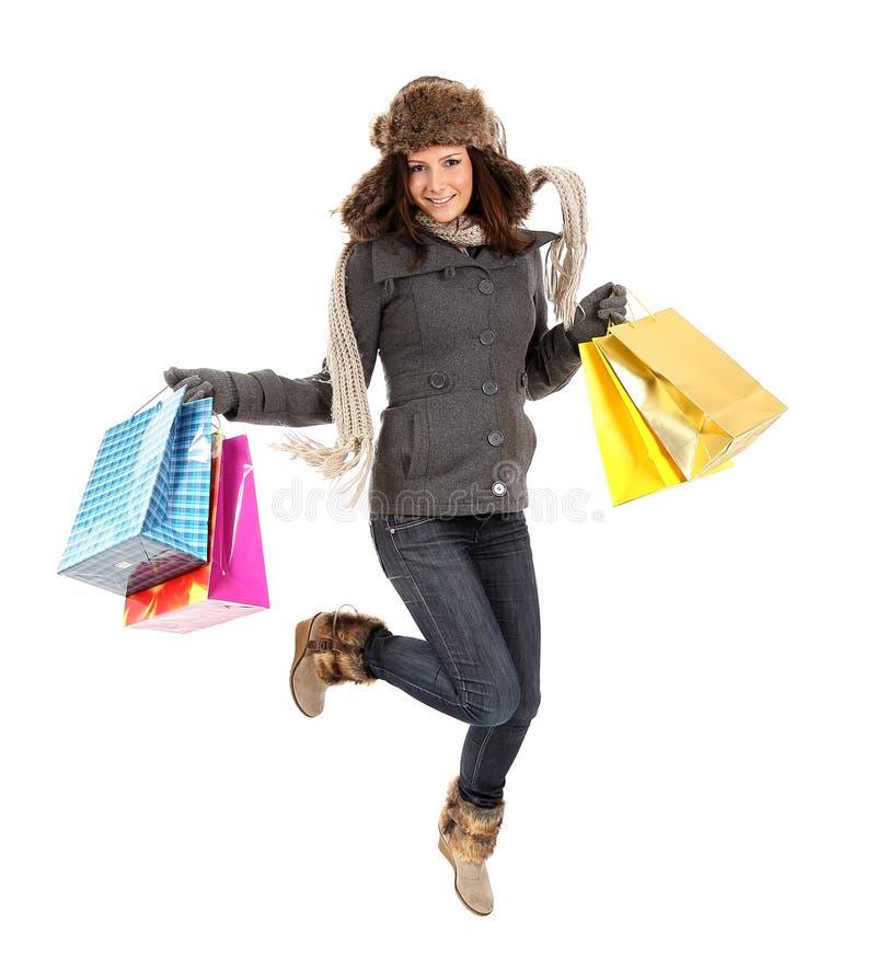 有购物袋跳的愉快的妇女 图库摄影