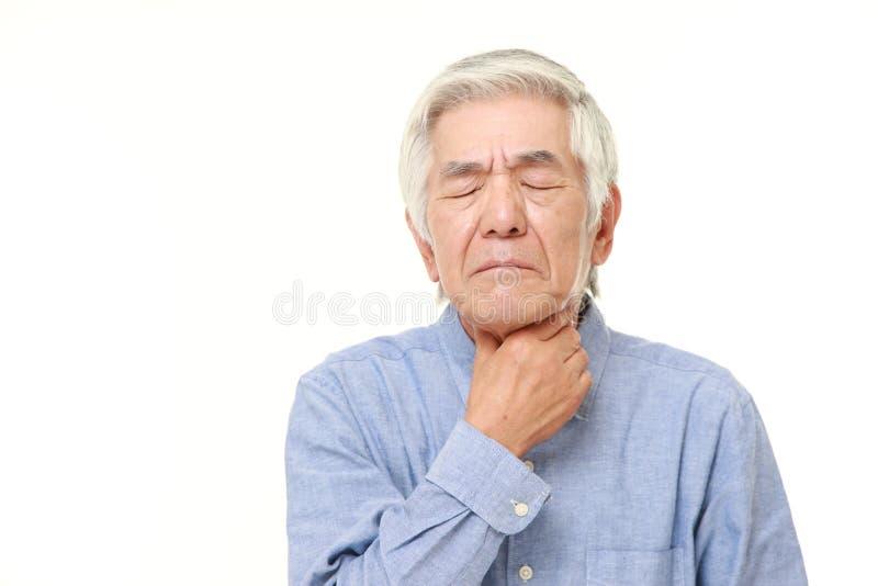 有资深日本的人喉头痛苦 库存图片