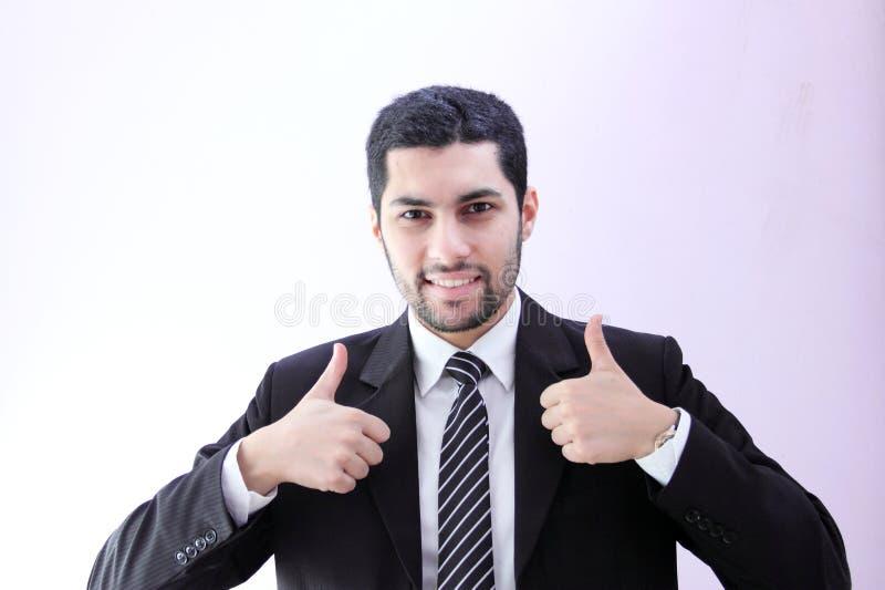 有赞许的愉快的阿拉伯商人 库存照片