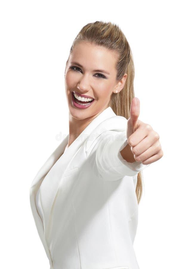有赞许的年轻美丽的妇女在白色 库存图片