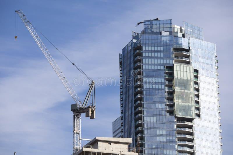 有起重机和脚手架的建造场所在多伦多,加拿大 图库摄影