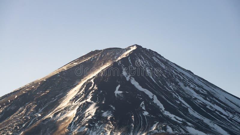 有较少雪的富士山在它的峰顶顶部 免版税库存图片