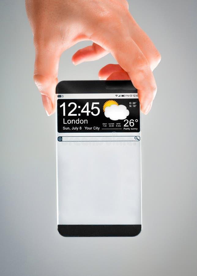 有透明屏幕的智能手机在人的手上。 免版税图库摄影