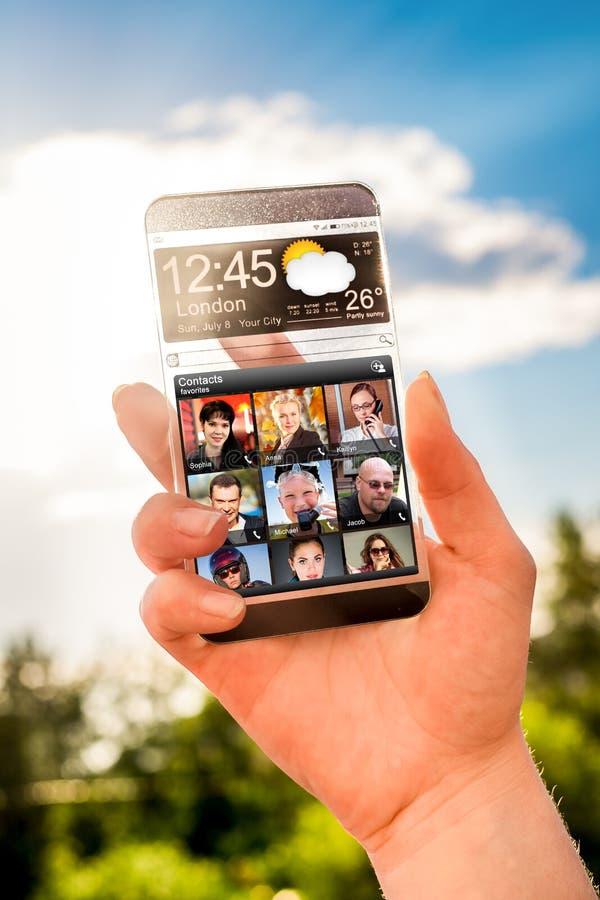 有透明屏幕的智能手机在人的手上 库存图片