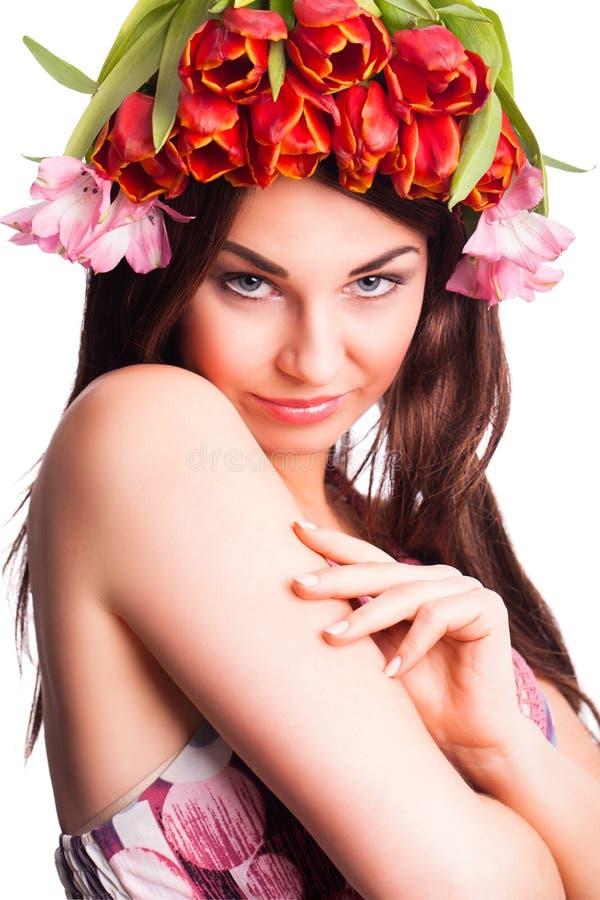 有郁金香头发装饰的美丽的妇女 库存图片