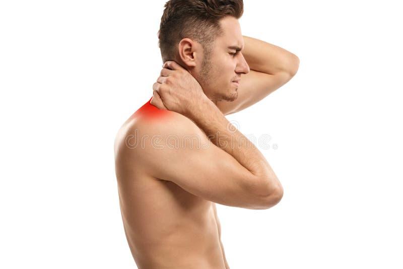 有酸疼的脖子的年轻人 免版税库存图片
