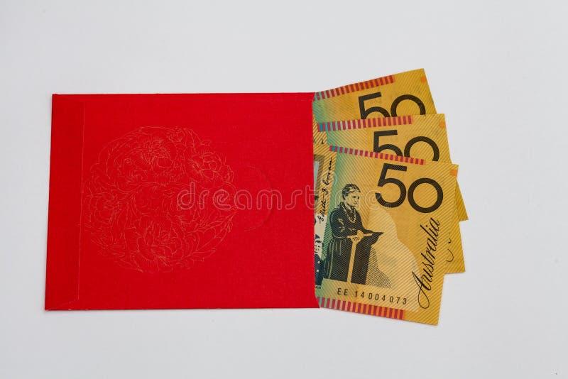 有里面澳大利亚金钱的红色口袋 免版税库存照片